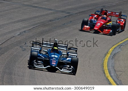 Newton, Iowa USA - July 17, 2015: Verizon IndyCar Series Iowa Corn Indy 300. 98 Gabby Chaves (R) Bogota, Colombia Bowers & Wilkins/Curb Honda BHA with Curb-Agajanian. On track in race practice.