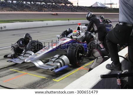 Newton, Iowa USA - July 18, 2015: Verizon IndyCar Series Iowa Corn Indy 300. 25 Justin Wilson Sheffield, England Andretti Autosport Honda. Pit stop action, gets fuel and tires. - stock photo