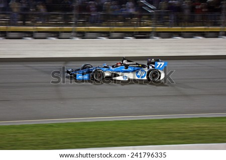 Newton Iowa, USA - June 23, 2012: Indycar Iowa Corn 250. Nightime racing action, under the lights, at Iowa Speedway. 77 Simon Pagenaud (R) Poitiers, France Schmidt Hamilton HP Motorsports