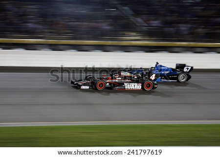 Newton Iowa, USA - June 23, 2012: Indycar Iowa Corn 250. Nightime racing action, under the lights, at Iowa Speedway. 4 JR Hildebrand Sausalito, Calif. National Guard Panther Racing - stock photo