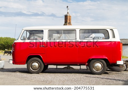 NEXO, DENMARK - JUNE 20: VW transporter T2 parked in Nexo, Bornholm, Denmark on June 20, 2014. The famous mini bus was manufactured for almost 64 years in 1949-2013. - stock photo