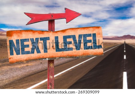 Next Level sign with road background - stock photo