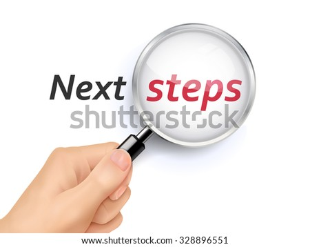 next steps words showing through magnifying glass held by hand