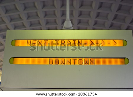 Next Train Downtown Sign in Commuter Rail Station - stock photo