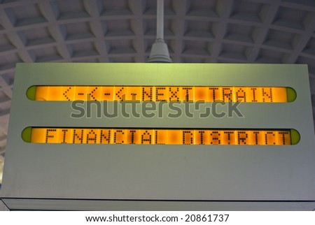 Next Train Financial Center Sign in Commuter Rail Station - stock photo