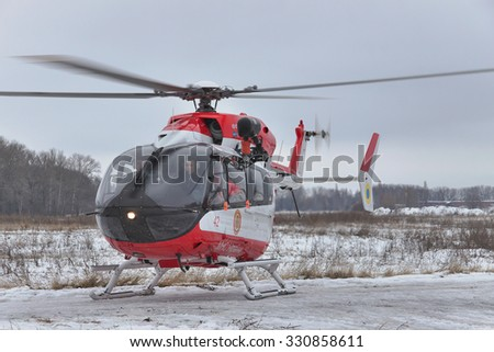 Nezhin, Ukraine - January 14, 2011: Ukrainian Ministry of Emergency Situations Eurocopter EC145 (BK-117) rescue helicopter taking off from the field - stock photo