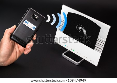 NFC payment technology The new way to pay. NFC payments via mobile phone - stock photo