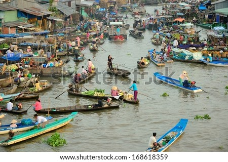 NGA NAM TOWN, SOC TRANG PROVINCE, VIETNAM - JAN 30: Unidentified trader on their boats at Nga Nam Floating Market on February 02, 2011. Nga Nam Market is one of most famous floating markets in VN. - stock photo