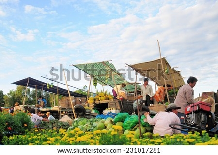 NGA NAM TOWN, SOC TRANG, VIETNAM - FEBRUARY 03, 2013: the trading activities on the floating market at Nga Nam. Nga Nam Market is one of most famous floating markets in Vietnam - stock photo