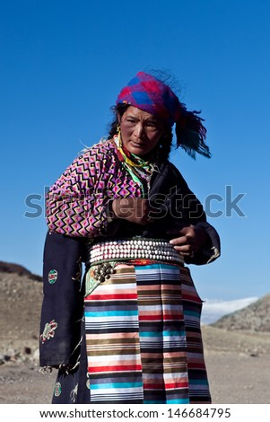 NGARI PREFECTURE, TIBET - MAY 07:  Unidentified Tibetan woman on the Kora trail around sacred mount Kailash on May 07, 2013 in Ngari Prefecture, Tibet Autonomus Region of China