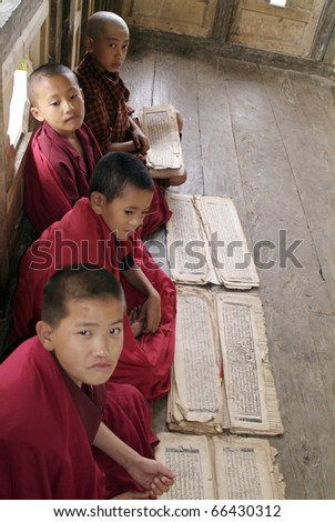 NGATSANG, BHUTAN - SEPTEMBER 28: unidentified young monks - novice - learning their holy books in the Ngamtrang Gompa on September 28, 2007 in Mongar, Bhutan