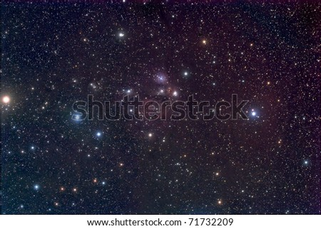 NGC 2170, A Reflection Nebula in the Constellation Monoceros - stock photo