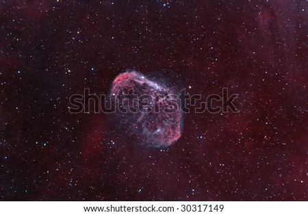 "NGC6888 ""Crescent"" Nebula. Supernova explosion remnants, among stars in the background. - stock photo"