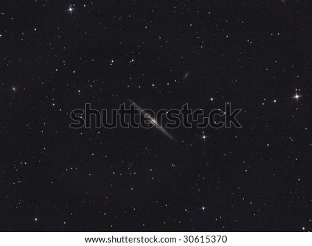 NGC 4565 Spiral galaxy in Coma Berenices - stock photo