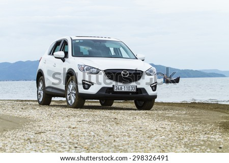 Nghe An, Viet Nam - July 18, 2015: Mazda CX-5 car running on the beach road in Vietnam