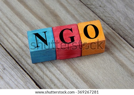 NGO (Non-Governmental Organization) sign on colorful wooden cube - stock photo