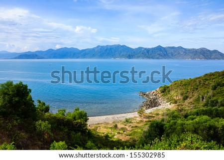Nha Trang bay, Vietnam.  View from Pham Van Dong (657) highway. It is in the north of Nha Trang city. Traveler could explorer the beautiful of Nha Trang beach from the highway. - stock photo