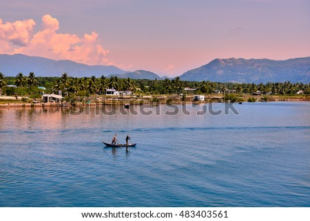 Nha Trang, Vietnam - May 02, 2013: The fisherman and his wife drive the boat to fish in the sea village