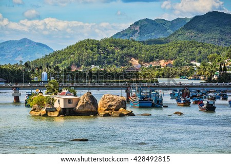 Nha Trang, Vietnam, NOV, 11, 2014. Boats and rocks near fishing village on the river Kai in Nha Trang