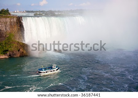 Niagara Falls and Maid of the Mist Tour Boat - stock photo