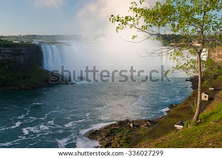 Niagara Falls at sunrise - cascading water in Ontario, Canada - stock photo