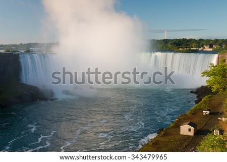 Niagara Falls at sunrise - cascading water in Ontario, Canada - stock photo