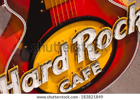 NIAGARA FALLS-CANADA,JULY 19,2007:Guitar at entrance.Hard Rock Cafe Niagara Falls has two very special rooms dedicated to Elvis and to the Beatles. - stock photo
