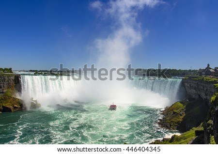 NIAGARA FALLS, CANADA - JUNE 14 2016: The famous Falls boat tour experience is North America's oldest attraction, and has drawn millions of visitors since 1846. Niagara Falls, Canada. - stock photo
