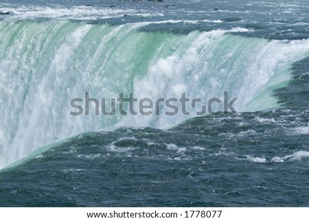 Niagara Falls Close Up of millions of gallons of foaming raging water - stock photo