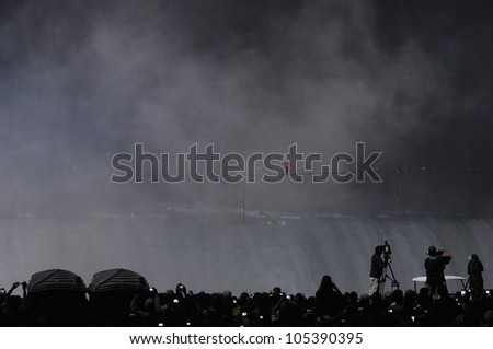 NIAGARA FALLS -JUNE 15: More than 120,000 people gathered from both sides of the border to watch  Nik Wallanda cross the Niagara Falls on a tightrope on June 15 2012 in Niagara Falls, Canada. - stock photo