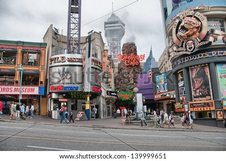 NIAGARA FALLS, USA - AUG 20: City streets life on a overcast summer day, August 20, 2009 in Niagara Falls, USA. Nearly 10 million people visit the city every year. - stock photo