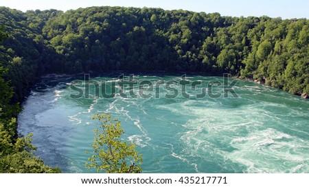 Niagara falls with Niagra bridge from the Canada side. - stock photo