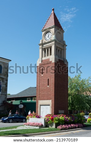 NIAGARA ON THE LAKE, CANADA-AUGUST 21, 2014: Tower with clock in  Niagara-on-the-Lake which is a Canadian town located in Southern Ontario where the Niagara River meets Lake Ontario - stock photo