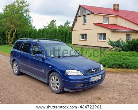 NICA, LATVIA - AUGUST 6, 2016: German car Opel Astra made in 2003 with 1.9 TDI diesel engine is parked in country house yard.