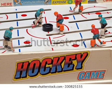 NICA, LATVIA - OCTOBER 23, 2015: Table hockey is one of most popular board games for relaxation and fun in winter season. Focus on puck in field center. - stock photo