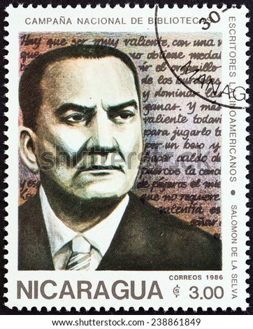 "NICARAGUA - CIRCA 1986: A stamp printed in Nicaragua from the ""National Libraries. Latin American Writers "" issue shows Salomon de la Selva (1893-1959), circa 1986. - stock photo"