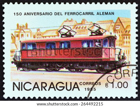 """NICARAGUA - CIRCA 1985: A stamp printed in Nicaragua from the """"150th anniversary of German Railroad """" issue shows Electric locomotive, Prussia, circa 1985.  - stock photo"""