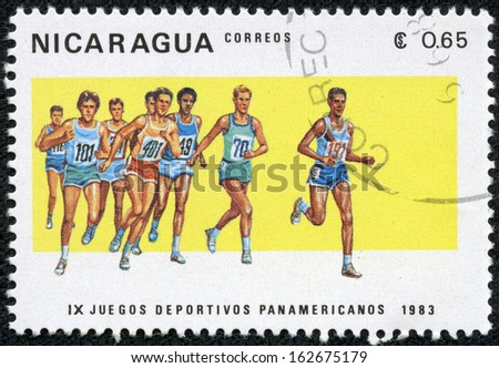 """NICARAGUA - CIRCA 1983: A stamp printed in Nicaragua from the """"9th Pan American Games, Caracas"""" issue shows running, circa 1983. - stock photo"""