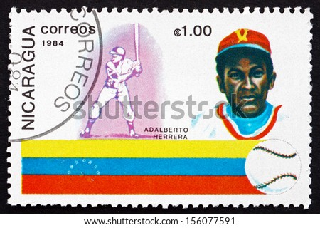 NICARAGUA - CIRCA 1984: a stamp printed in Nicaragua shows Adalberto Herrera, Baseball Player, Venezuela, History of Baseball, circa 1984 - stock photo