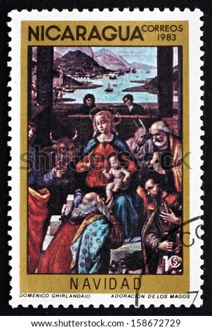 NICARAGUA - CIRCA 1983: a stamp printed in Nicaragua shows Adoration of the Kings, Painting by Domenico Ghirlandaio, Christmas, circa 1983 - stock photo