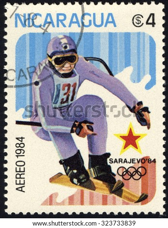 NICARAGUA - CIRCA 1984: A stamp printed in Nicaragua shows Downhill skiing, circa 1984 - stock photo