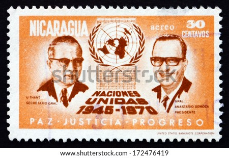 NICARAGUA - CIRCA 1972: a stamp printed in Nicaragua shows U Thant, Anastasio Somoza, UN Emblem, 25th Anniversary of the United Nations, circa 1972 - stock photo