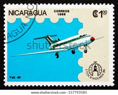 NICARAGUA - CIRCA 1986: a stamp printed in Nicaragua shows YAK 40, Airplane, circa 1986 - stock photo