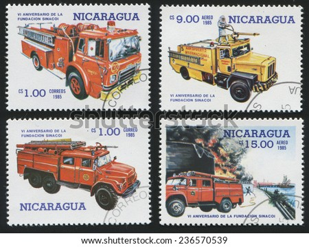 Nicaragua - CIRCA 1985: Set of postage stamp printed in Nicaragua, shows various models of fire engines. Red and yellow vehicles. Fire fighting., circa 1985 - stock photo