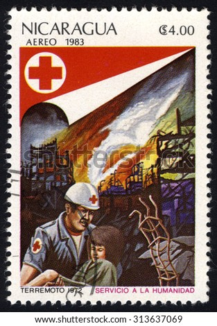 NICARAGUA - CIRCA 1983: Stamp printed by Nicaragua, shows Salvation by fire, from series Red Cross, circa 1983 - stock photo