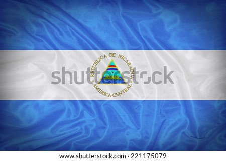 Nicaragua flag pattern on the fabric texture ,vintage style - stock photo