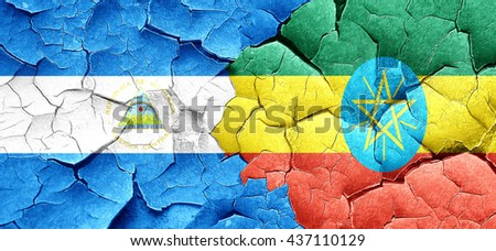nicaragua flag with Ethiopia flag on a grunge cracked wall - stock photo