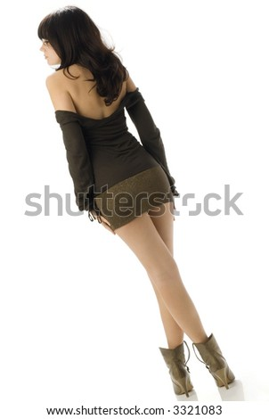 nice and attractive brunette wearing a mini and sexy brown dress - stock photo