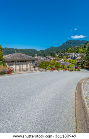 Nice and comfortable great neighborhood. Some homes on the empty street in the suburbs of Vancouver, Canada. Vertical. - stock photo