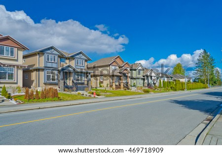 Nice and comfortable neighborhood. A row, line of the townhouses, homes on empty street in the suburbs of Vancouver, Canada.